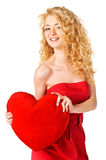 Beautiful happy woman with a heart Royalty Free Stock Images