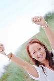 Beautiful happy woman holding blank sign Stock Images