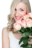 Beautiful happy woman holding a bunch of roses Stock Photos