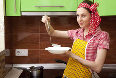 Beautiful happy woman in kitchen interior cooking Royalty Free Stock Images