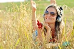 Beautiful happy woman listening to mus Royalty Free Stock Photo