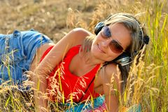 Beautiful happy woman listening to music Royalty Free Stock Photography