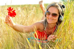 Beautiful happy woman listening to music Royalty Free Stock Image