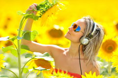 Beautiful happy woman listening to music Stock Photography