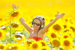 Beautiful happy woman listening to music Stock Photos