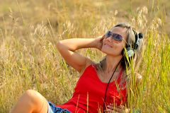 Beautiful happy woman listening to music Royalty Free Stock Images