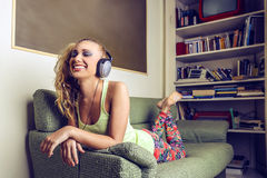 Beautiful happy woman listening to the music Royalty Free Stock Photography