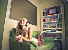Beautiful happy woman listening to the music Royalty Free Stock Image