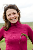 Beautiful happy woman with a lizard on her breast Royalty Free Stock Photography