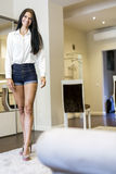 Beautiful happy woman with long legs in a nice white room Royalty Free Stock Photography