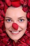 Beautiful happy woman lying in petal roses Royalty Free Stock Images