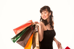 Beautiful happy woman with many shopping bags. Shopping concept. Stock Images
