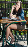 Beautiful happy woman with mobile phone in cafe Stock Photo