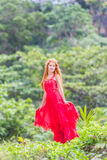 Beautiful happy woman on natural tropical background Stock Photos