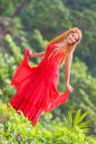 Beautiful happy woman on natural tropical background Royalty Free Stock Photo