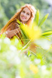 Beautiful happy woman on natural tropical background Stock Photography