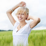 Beautiful happy woman in nature Stock Images
