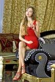 Beautiful Happy Woman On A Sofa Royalty Free Stock Image