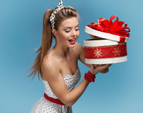 Beautiful happy woman opening gift box Royalty Free Stock Photography
