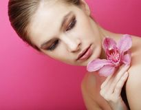 Beautiful happy woman with orchid flower Stock Photography