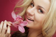 Beautiful happy woman with orchid flower Royalty Free Stock Photography