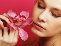 Beautiful happy woman with orchid flower Royalty Free Stock Images