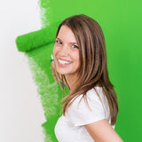 Beautiful happy woman painting a wall Royalty Free Stock Photos