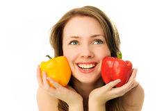Beautiful happy woman with peppers Royalty Free Stock Images