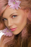 Beautiful  happy woman with pink hair and flowers Stock Photo