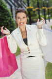 Beautiful Happy Woman With Pink and White Shopping Bags Royalty Free Stock Photography