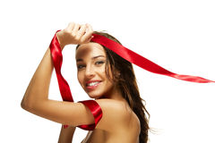 Beautiful happy woman playing with a red ribbon Royalty Free Stock Photography