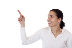Beautiful happy woman pointing at ad space Stock Photo