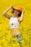 Beautiful happy woman on rape field in bloom Royalty Free Stock Photo
