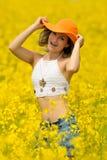 Beautiful happy woman on field in bloom Royalty Free Stock Photo