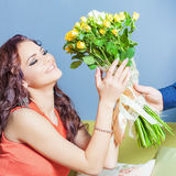 Beautiful happy woman received a flower bouquet of roses Royalty Free Stock Images