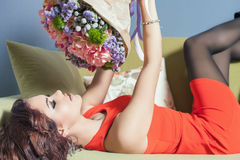 Beautiful happy woman received a flower bouquet of tulips Stock Photos