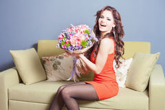 Beautiful happy woman received a flower bouquet of tulips Royalty Free Stock Photo
