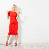 Beautiful happy woman in red dress Stock Photography