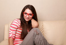 Beautiful happy woman in red glasses relaxing Stock Photography