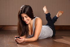 Beautiful happy woman relaxed reading text message Royalty Free Stock Photo