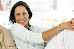 Beautiful happy woman relaxing at home - close up portrait royalty free stock photo