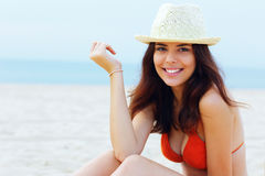 Beautiful happy woman resting on the beach Stock Images