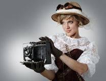 Beautiful happy woman with retro camera. Royalty Free Stock Photography