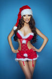 Beautiful happy woman in Santa Claus Royalty Free Stock Image