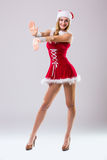 Beautiful happy woman in Santa Claus clothes Royalty Free Stock Photography