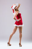 Beautiful happy woman in Santa Claus clothes Royalty Free Stock Photo