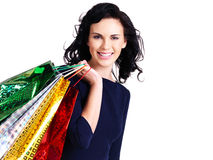 Beautiful happy woman with shopping bags. Royalty Free Stock Photos