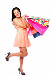 Beautiful happy woman with shopping bags Stock Images