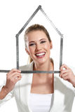 Beautiful happy woman showing an house symbol Stock Photo