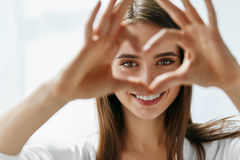 Beautiful Happy Woman Showing Love Sign Near Eyes. Healthy Eyes And Vision. Portrait Of Beautiful Happy Woman Holding Heart Shaped Hands Near Eyes. Closeup Of stock image